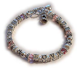 Peace Love & Joy Bracelet. This sterling silver and Swarovski crystal Peace, Love & Joy Bracelet comes in 12 Swarovski crystal colors. You choose the color and size. The price includes the sterling silver angel playing the harp charm and sterling silver puffed heart charm. This bracelet has a lot of silver in it!