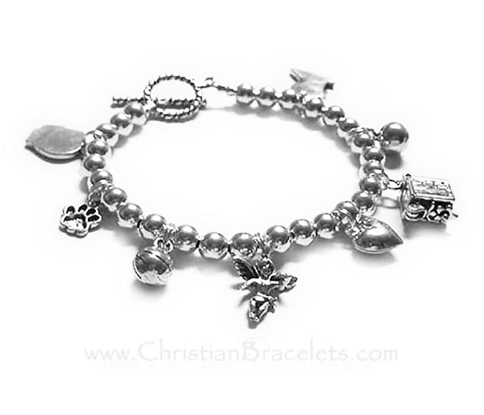 CB-CB10 This bracelet is shown with a free toggle clasp and 8 sterling silver charms; boy profile, paw print, basketball, angel with wings, puffed heart, prayer box, soccer ball, girl profile with a round toggle clasp.
