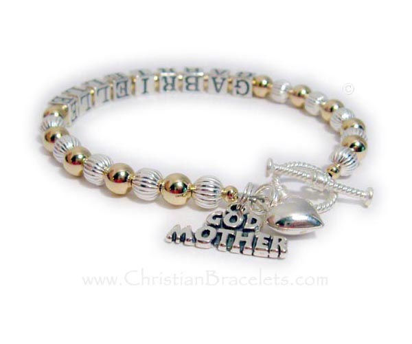 This Gold and Sterling silver Godmother Charm Bracelet is shown with the Godchild's name, Gabrielle. The Godmother charm is included in the price. They added a Puffed Heart Charm. A toggle clasp is shown.
