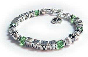 Peace Love Joy Bracelet with any color crystals (August shown) and a PEACE charm.