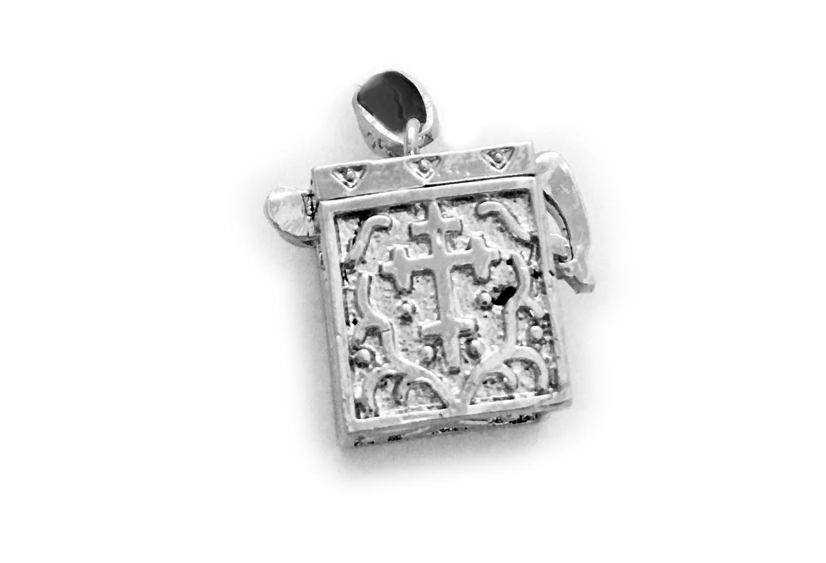 Silver Prayer or Blessing Box Charm. It is hinged so it opens and you can slip or whisper a prayer inside.