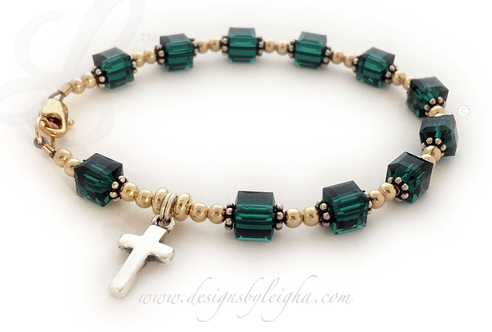 Gold May Emerald Rosary Bracelet This Rosary Bracelet is shown with 14k gold-filled beads and 14k gold-plated lobster claw clasp. They picked May or Emerald 6mm Square Birthstone Crystals. The bead caps are .925 sterling silver flower beads. The Simple Sterling Silver Cross Charm is included in the price.