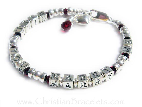 "Sterling silver WILL YOU MARRY ME bracelet. This sterling silver Message 1 bracelet is shown with ""WILL YOU MARRY ME"" written on it, July or Ruby Red crystals and 2 add-ons; Puffed Heart charm and July/Ruby (red) birthstone crystal dangle.  Shown with a lobster claw clasp."