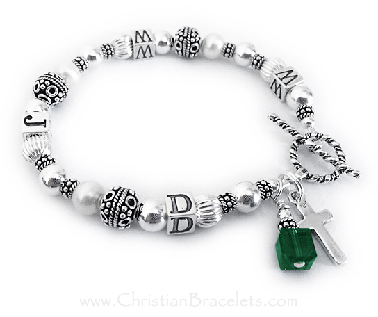 WWJD Bracelet shown with a Sterling Silver Simple Cross Charm. They also added a Birthstone Crystal Dangle - Emerald/May
