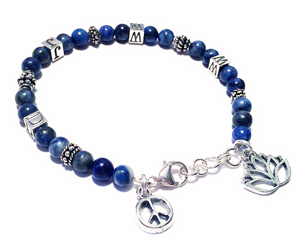 What Would Jesus Do Bracelet with a Peach Sign charm and a Lotus Flower with an extension clasp.