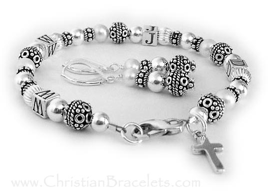 WWJD Bracelet with an add-on Sterling Silver Simple Cross Charm and they also added coordinating earrings.