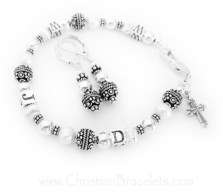 WWJD Bracelet shown with an add-on FANCY cross charm and they also added coordinating earrings.