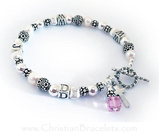 WWJD Bracelet shown with an add-on Sterling Silver Simple Cross Charm and a Birthstone Crystal Dangle for October