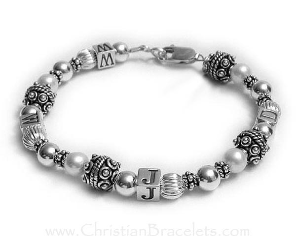 WWJD Sterling Silver  Bracelet with Swarovski Pearls and beautiful decorative Bali Beads. The WWJD is spread out throughout the bracelet. This bracelet is shown with one of my free lobster claw clasps. CB-WWJD-1