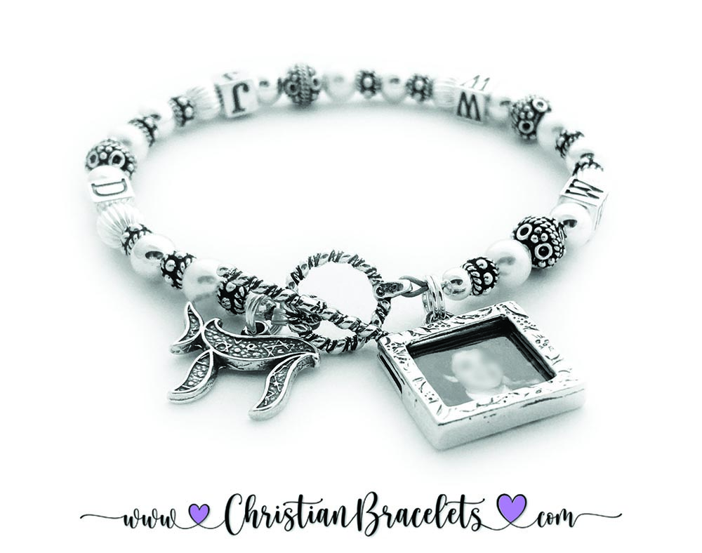 CB- WWJD-1S  WWJD Bracelet shown with a 2 sterling silver charms: Square Textured Picture Frame Charm and a Chai Charm. Clasp: Twisted Toggle Clasp  Size: 7 3/4""