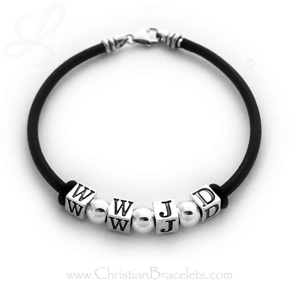 """WWJD"" (with spacers)  CB- WWJD-4 Bracelet WWJD Leather Cord Bracelet Shown on an 7 1/2"" leather and sterling silver bracelet and 3 - .925 sterling silver spacers. Shown with free ""stoppers"" that can be MOVED anywhere on the bracelet (or taken off)."