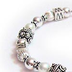 WWJD bracelet with pearls and sterling silver
